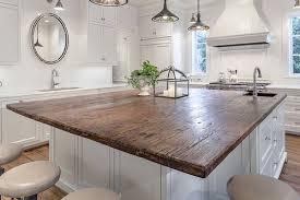 reclaimed pine countertops look wonderful in a predominately white kitchen