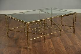 faux bamboo brass and glass coffee table with two small nesting tables glass top brass tables