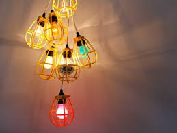 industrial light of bulbs and bird cages via shelterness
