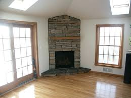 fashionable corner fireplace designs corner stone fireplaces designs with wooden floor decor idea fascinating corner fireplace
