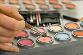 professional makeup kits. makeup artist using tools professional kits