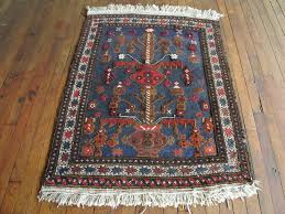 She is a beautiful 50 year old, unique looking vintage Persian Kilim rug.  Afina's bold dark navy blue, red, and gold accents and low pile make her a  perfect ...