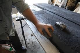 el granto wet sanding the undersides of the countertops