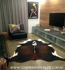 brown cowhide rug ikea natural white grey one of our reddish rugs shown in a living faux brown and white cowhide rug
