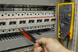 circuit breaker panel stock photos & pictures royalty free Electric Circuit Breaker Panel Wiring circuit breaker panel electrical engineer measuring voltage on a miniature circuit breaker circuit breaker panel wiring diagram pdf