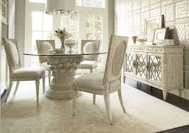 white glass pedestal dining table design with gorgeous flower dining rug and mid century dining cabinet from cochrane dining room furniture design small