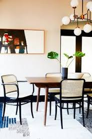 mid century modern dining room design with a white peachy tan beige