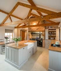 Wooden Kitchen Countertops Stunning Long Wooden Countertop Bar Stools Wallmount Cabinets