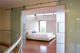 gl barn door bedroom contemporary with beige platform bed chrome image by llb architects