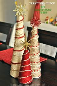 this tutorial shows you how to use yarn, styrofoam cones and ornaments to  create a beautiful christmas tree decoration for your home!
