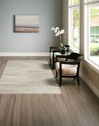 armstrong luxury vinyl plank nice color scheme grey wood beige carpet even like the pattern luxe furnishing and costal colored walls