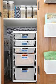 the most impactful set of drawers was added at the bottom of the closet via a narrow elfa drawer unit originally the closet had a single shelf and the