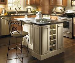 close up of ivory island in kitchen with jordan maple ginger cabinets jordan light