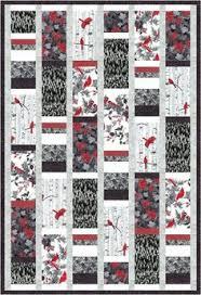 Easy woven quilt pattern -- triangles   HST and other triangles ... & Black and white and red to pop. Larger rectangles wih another long block of  stacked strips. Free Quilt Pattern: Woodsy Winter black-white, ... Adamdwight.com