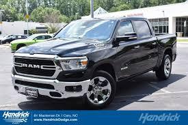 CERTIFIED PRE-OWNED 2019 RAM 1500 BIG HORN/LONE STAR REAR-WHEEL DRIVE 4 DOOR CREW CAB TRUCK