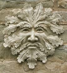 wise green man decorative stone wall