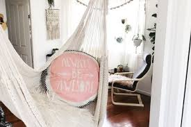 monochromatic indoor hammock living room