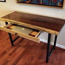 custom made walnut live edge desk with hand forged metal legs and custom laptop