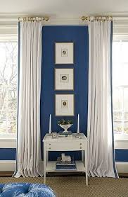 Bedroom by Kelley Proxmire with white curtains with blue trim and ...