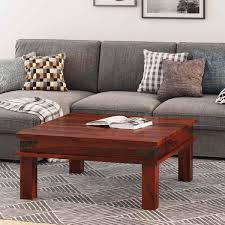 The best way to tie your room together is with a stylish coffee table. Altamont Transitional Solid Wood Square Coffee Table
