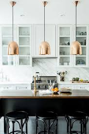 image modern kitchen lighting. modern kitchen with rosy metalic pendant lights and marble backsplash image lighting