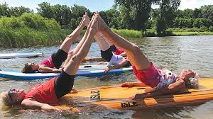 Enjoy some yoga at the beach in Shelby Township after a long day