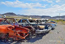 just a crane a back hoe and some elbow grease could make this horizontal cadillac ranch reach new heights