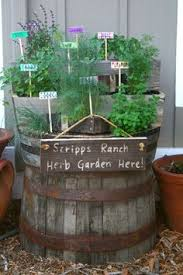 barrel garden. Wine Barrel Garden - A Pop Of Color Contained For Small Space And Easier Upkeep. | The Home Pinterest Spaces, Barrels Spaces