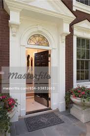 elegant front doors. FRONT DOORS; Entrance To An Elegant Federal Style Home, Arched Palladian Window Over Door, Portico With Fluted Pilasters, Corbels, Traditional Georgian Front Doors