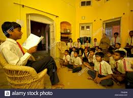 boy reading essay to class mates in the music room of nanhi dunya  boy reading essay to class mates in the music room of nanhi dunya school dehradun uttaranchal mr 711