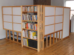 interior white room partition with brown wooden frames completed by brown wooden shelves on brown