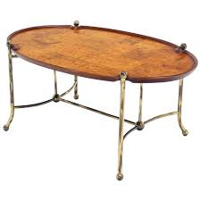 patch burl wood top and brass base oval coffee table for