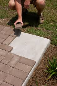image result for lay pavers on concrete patio