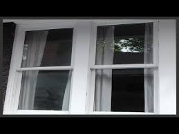 how to clean hard water spots off windows