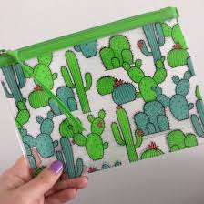 i just bought this make up bag from h m i m really drawn to cactus ilrations at the moment nail polish is play date by essie