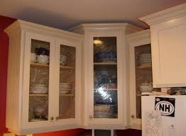 white wall mounted kitchen cabinet doors with glass