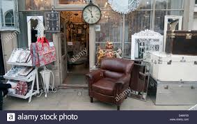 vintage display on the pavement outside an antique furniture shop