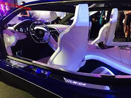opening to the front and to the back revealing a luxurious and sporty interior power is sporty too it has two electric motors together good for