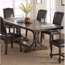 keshia pedestal extendable dining table