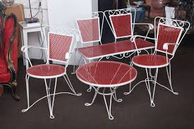 unique white and red wrought iron patio set consists of two matching chairs a