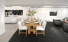 view in gallery large textured black rug in a dining and living area