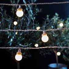 100 warm white led outdoor connectable pro series festoon party lights on white cable by lights4fun co uk garden outdoors