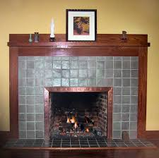 hammered copper fireplace surround with antique brass s shown in medium antique patina