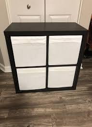 ikea kallax storage shelf 2x2 brown black with 4 white bins