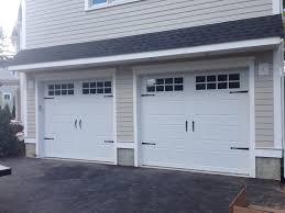 chi overhead doors model 5916 long panel steel carriage house style garage doors in white