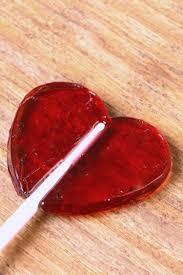 red glossy heart shaped lollipop