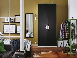 bedroom black furniture. a bedroom with white wardrobe black doors combined bed and furniture