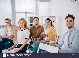 Smiling Business People In Casual Clothing Having Business