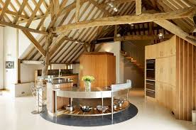 Kitchen in a barn conversion with round central island