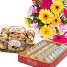 seasonal flowers with kaju barfi n chocolates